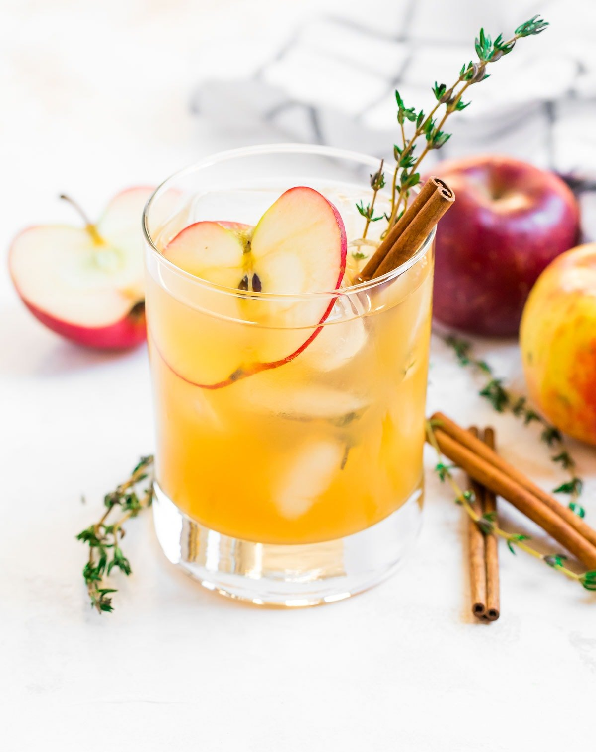 Apple cider cocktail with cinnamon and apple