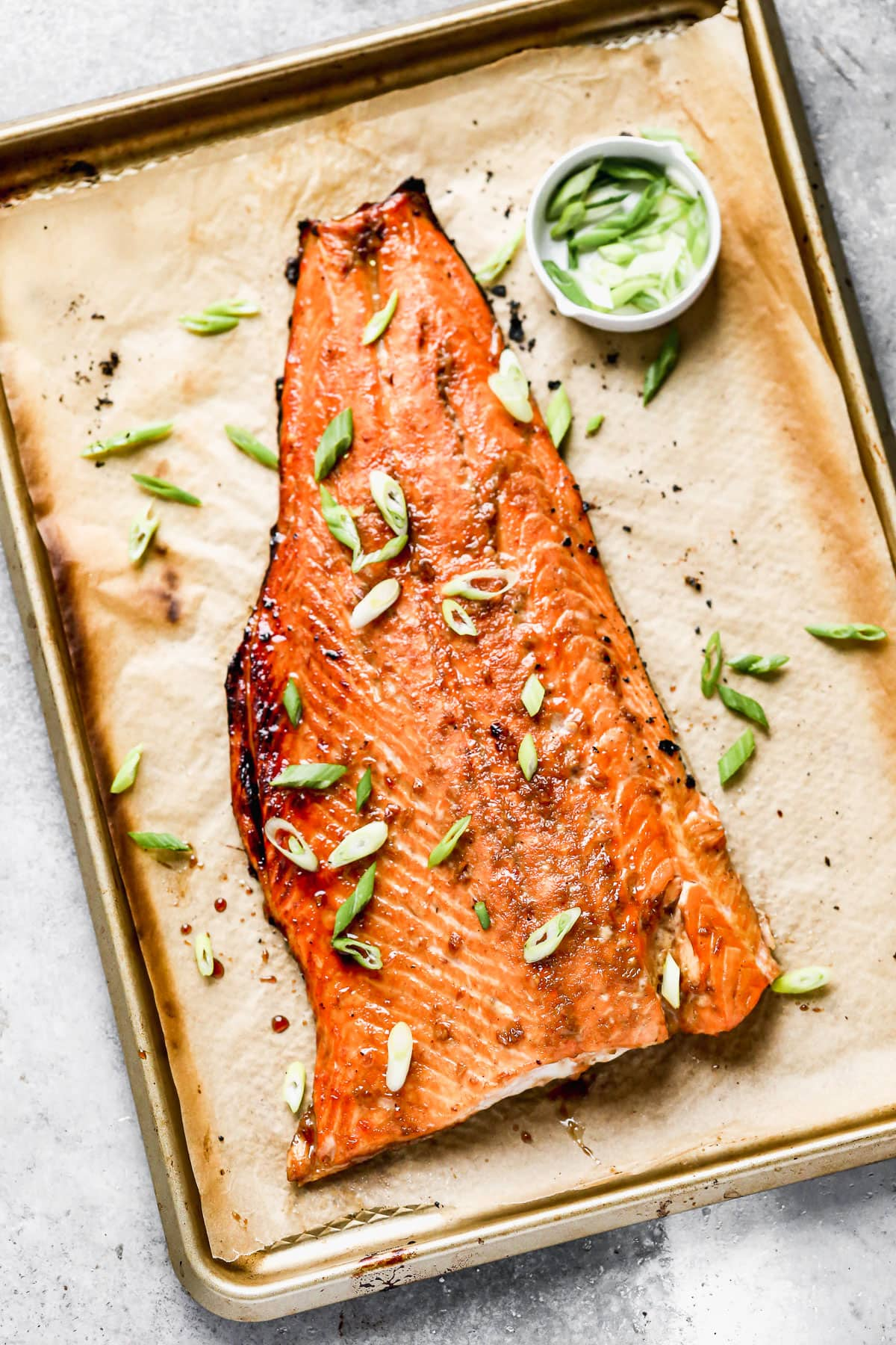 A baking sheet with a fillet of bourbon glazed salmon