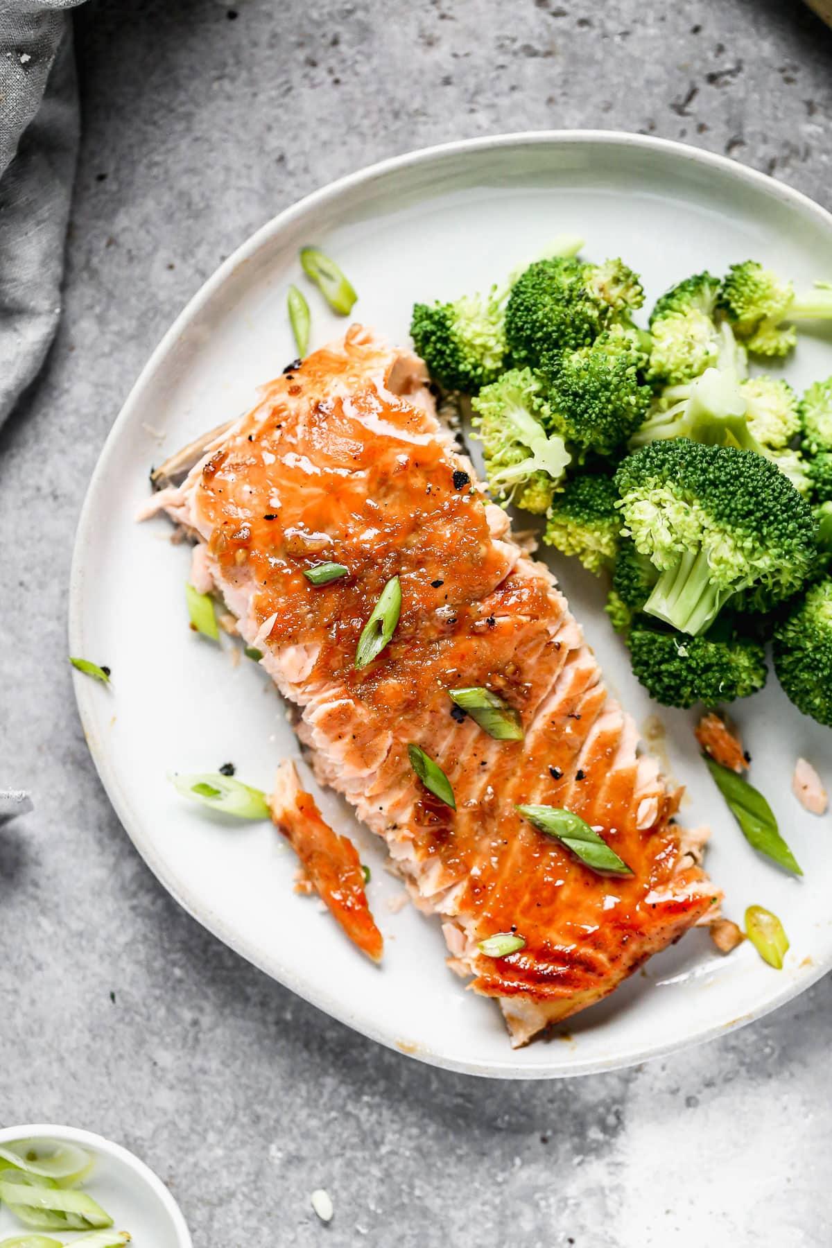 A plate of bourbon glazed salmon and broccoli