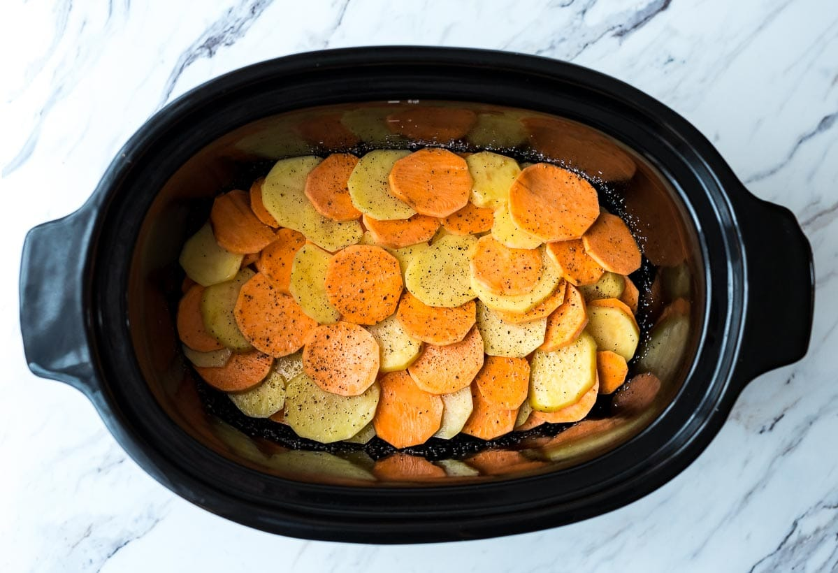 Thinly sliced potatoes in a slow cooker