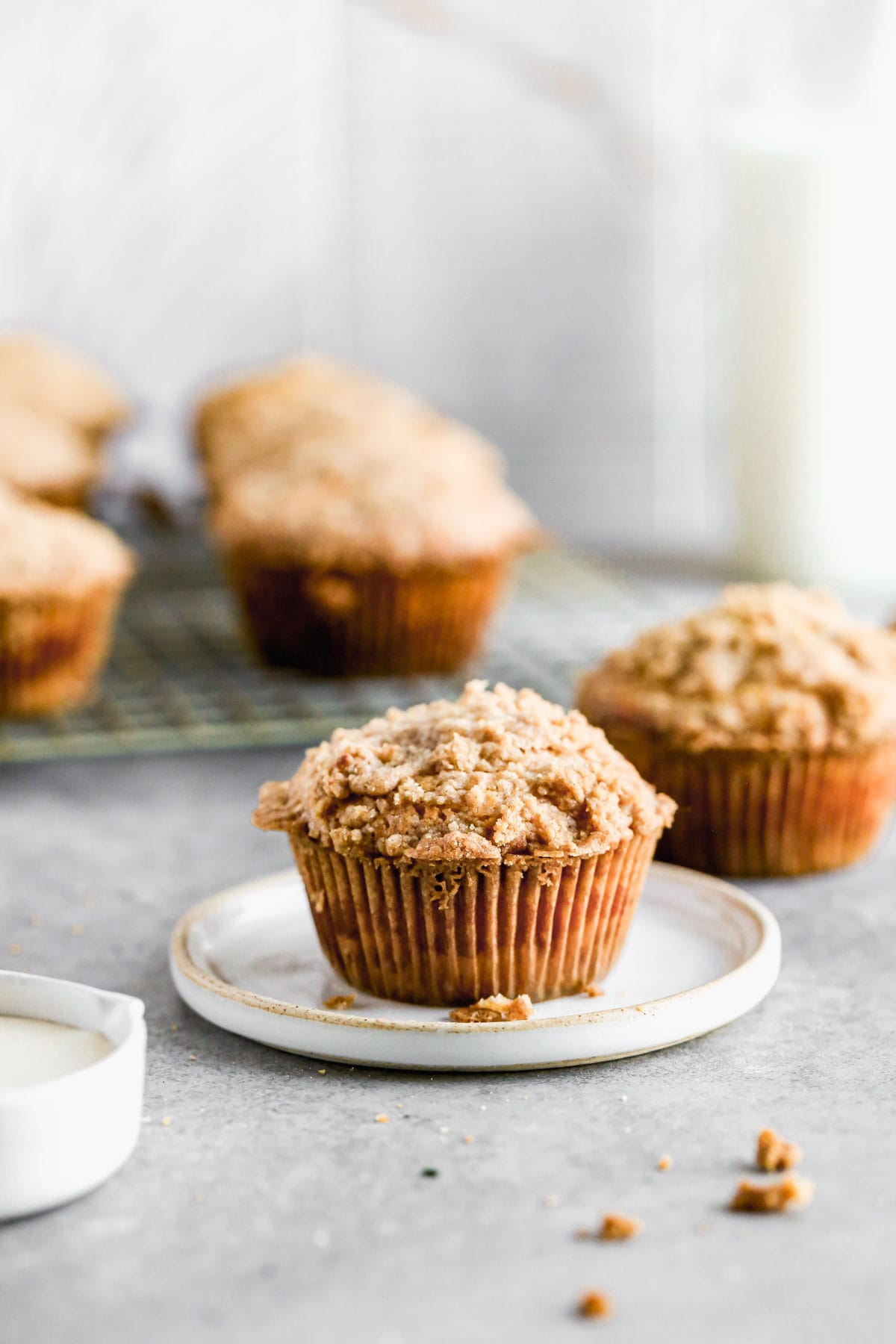 A plate with a coffee cake muffin