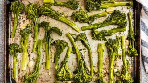 Garlic roasted broccolini on a baking sheet
