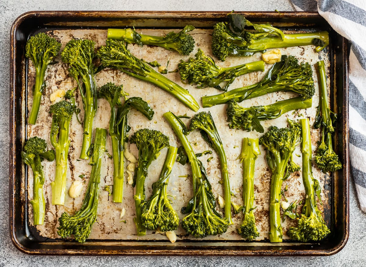 Garlic roasted broccolini on a baking sheet