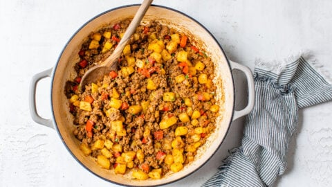 Ground beef with potatoes and peppers in a Dutch oven