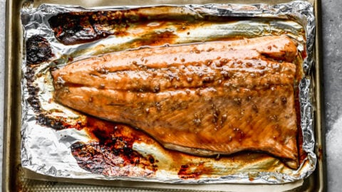 A large piece of fish on a baking sheet