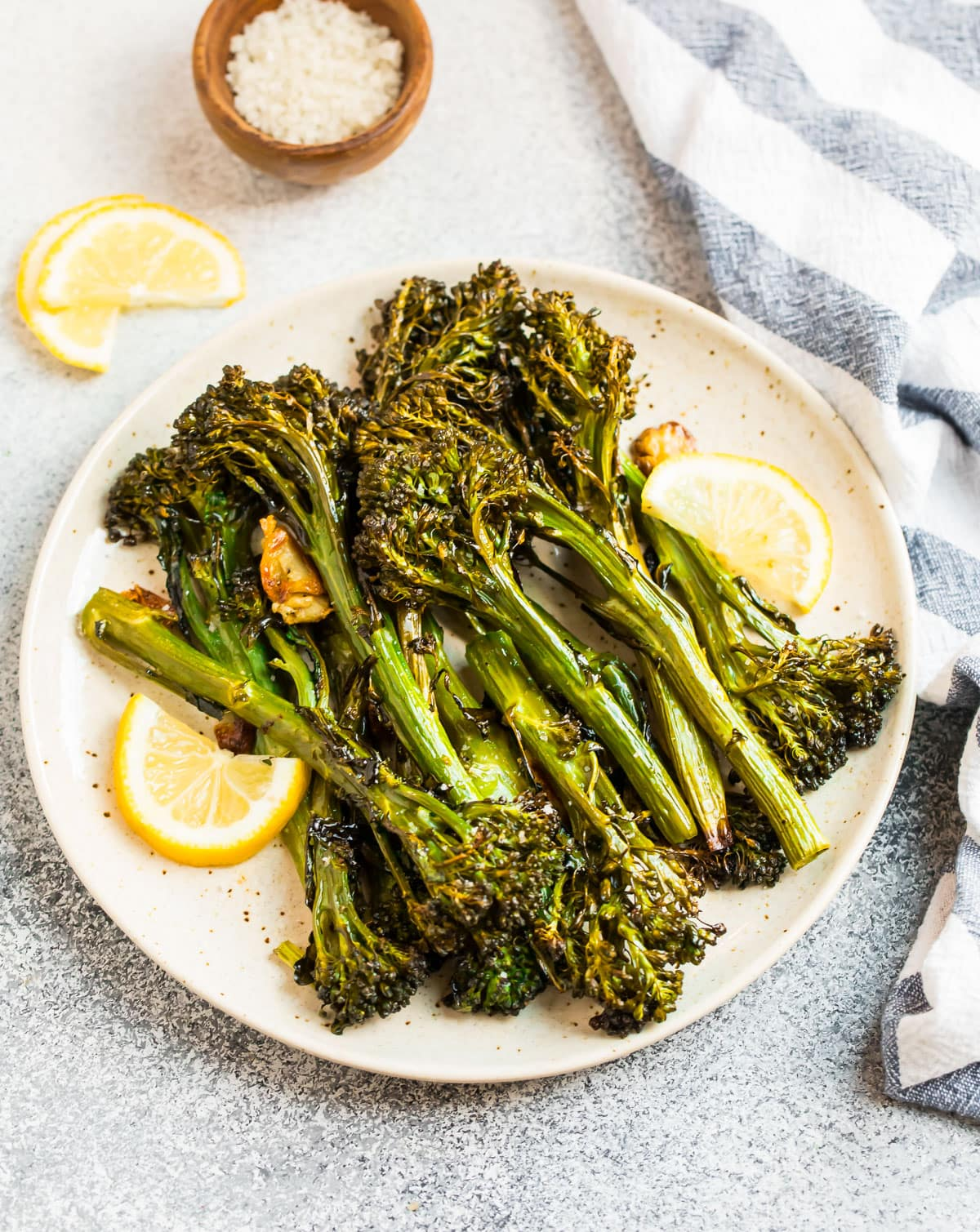 Lemons and roasted broccolini on a plate