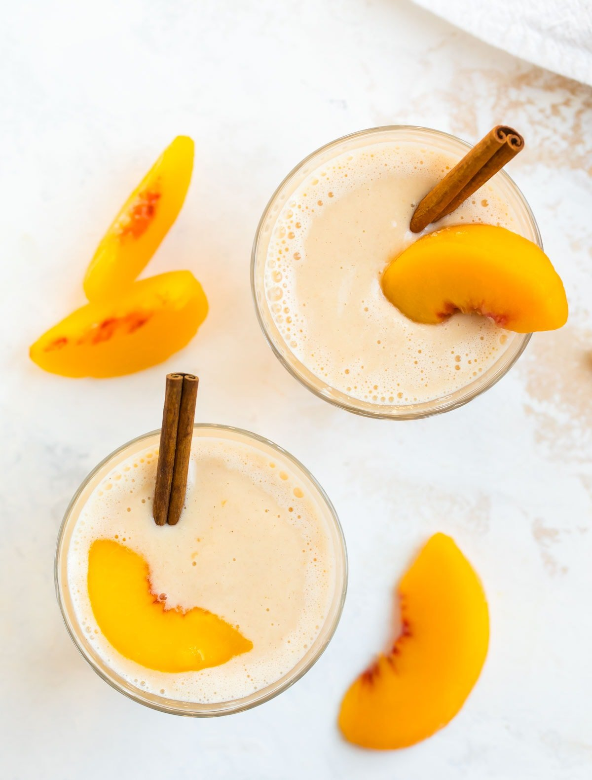 Two healthy drinks with fruit and spices