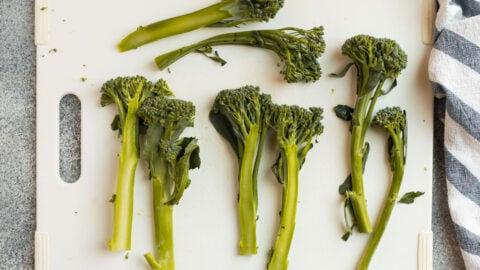 Broccolini on a cutting board