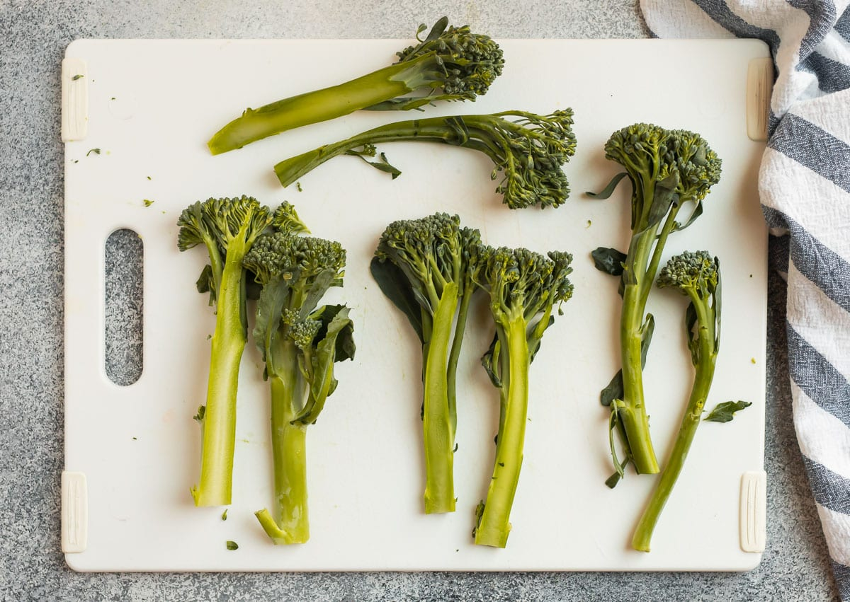 Broccolini on a cutting board