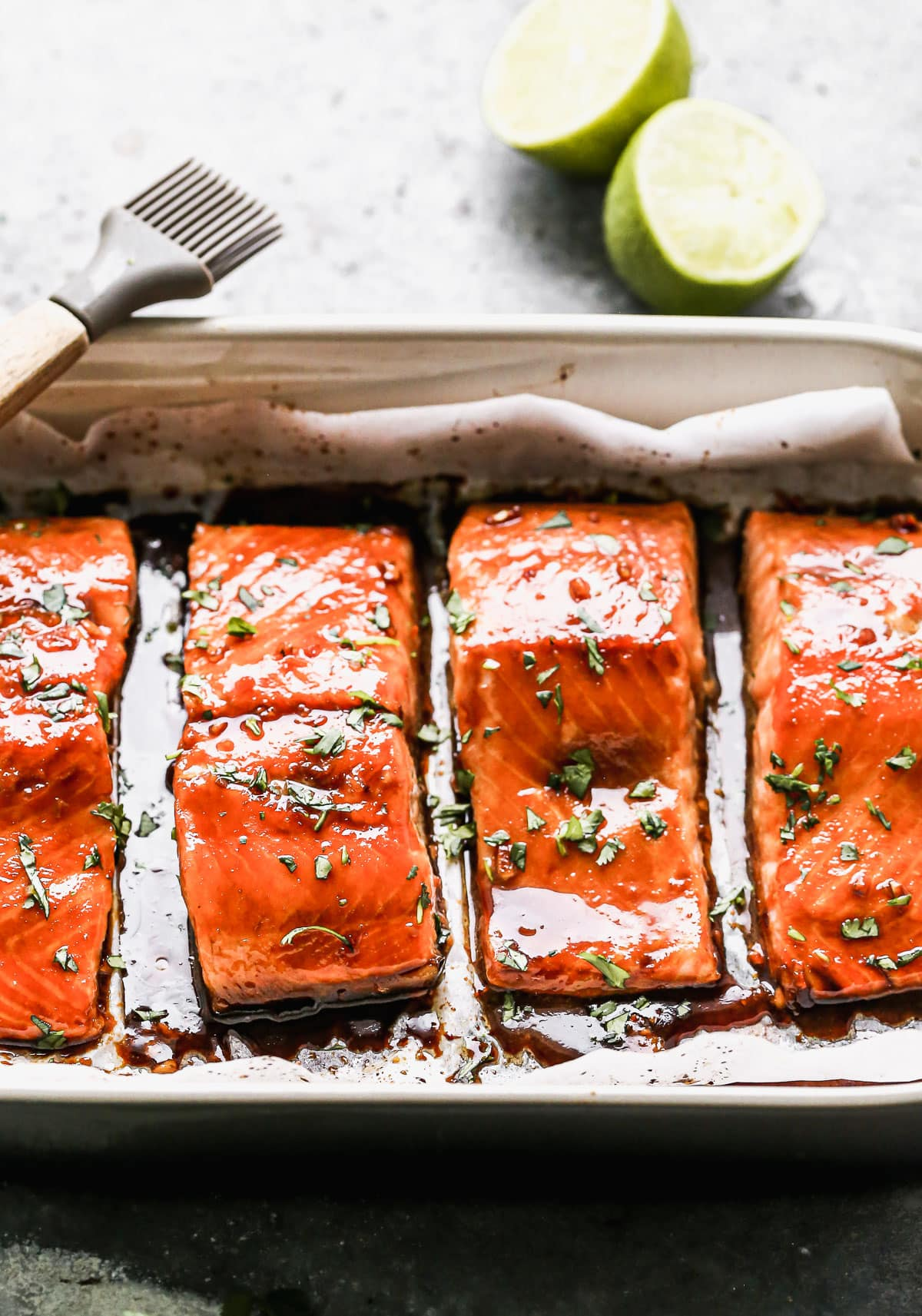 Honey glazed salmon fillets in a baking dish