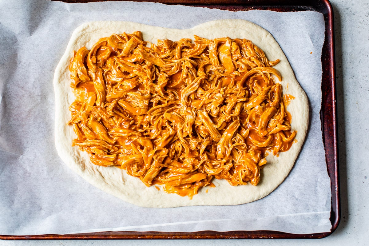 Shredded meat on dough