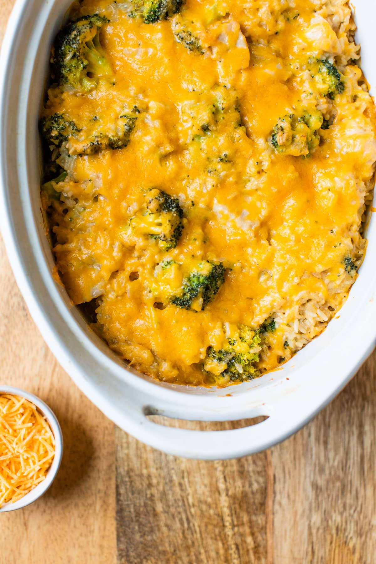 Chicken broccoli rice casserole with cheese on top