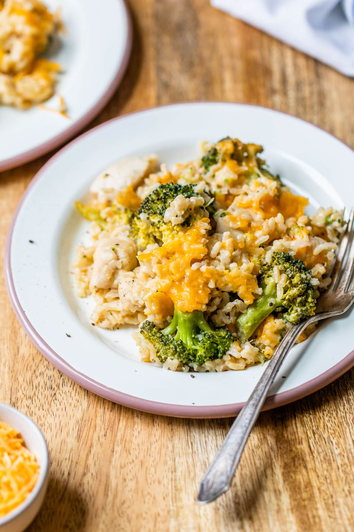 Cheesy chicken broccoli rice casserole served on a plate