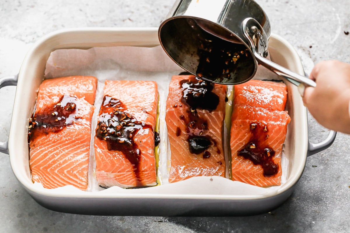 Glaze being poured over salmon