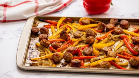Italian sausage and peppers on a baking sheet