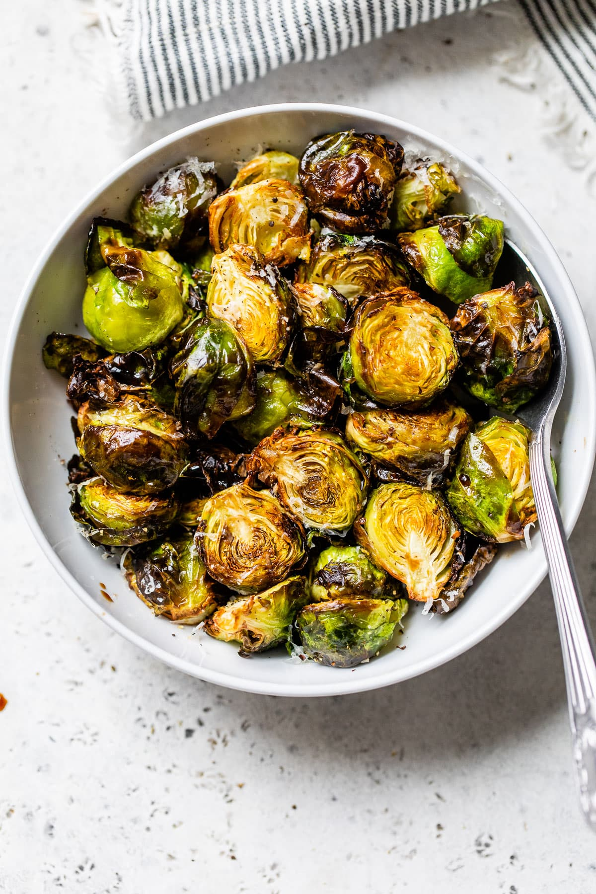 Brussels sprouts in a bowl with a spoon