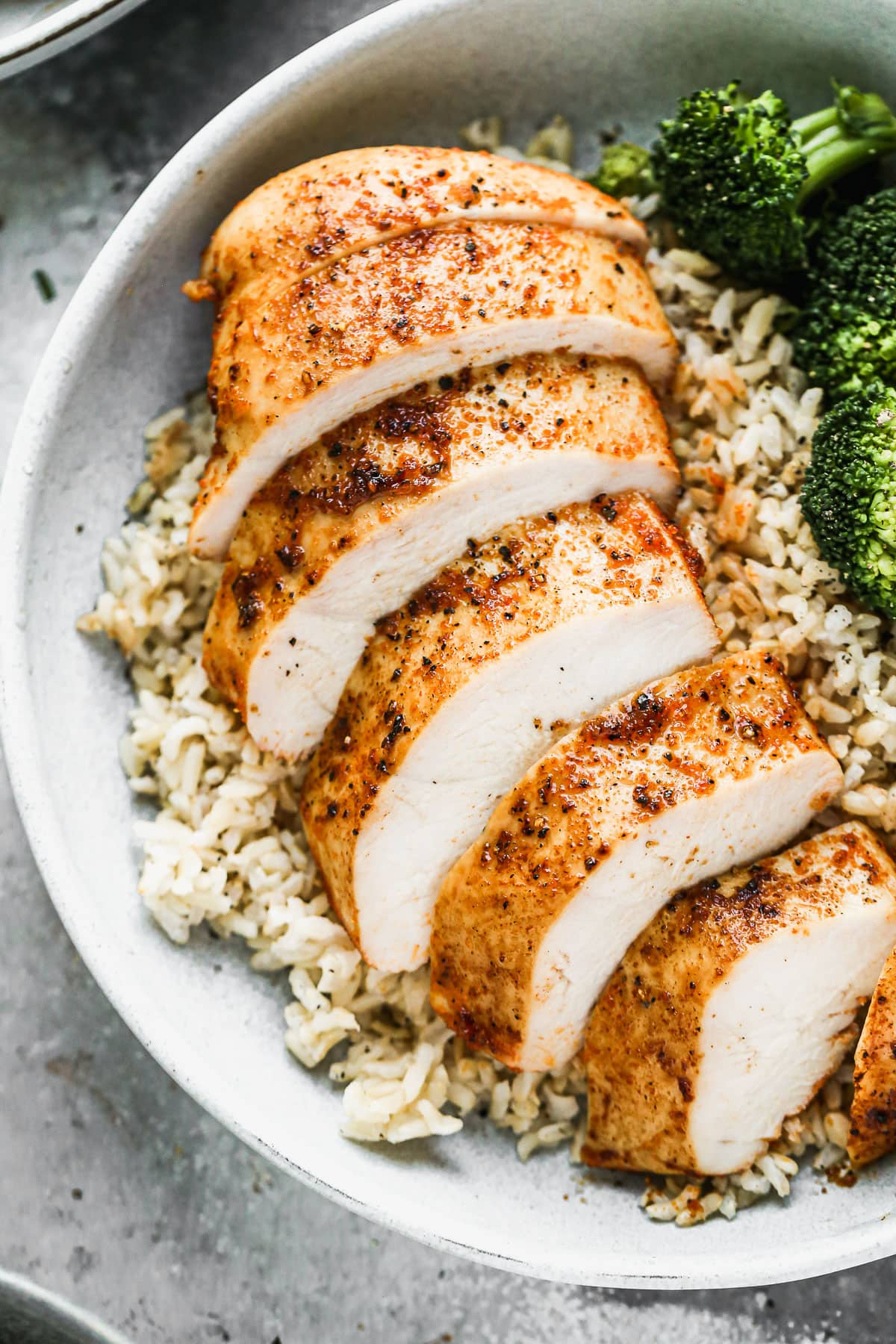 A sliced oven roasted chicken breast in a bowl