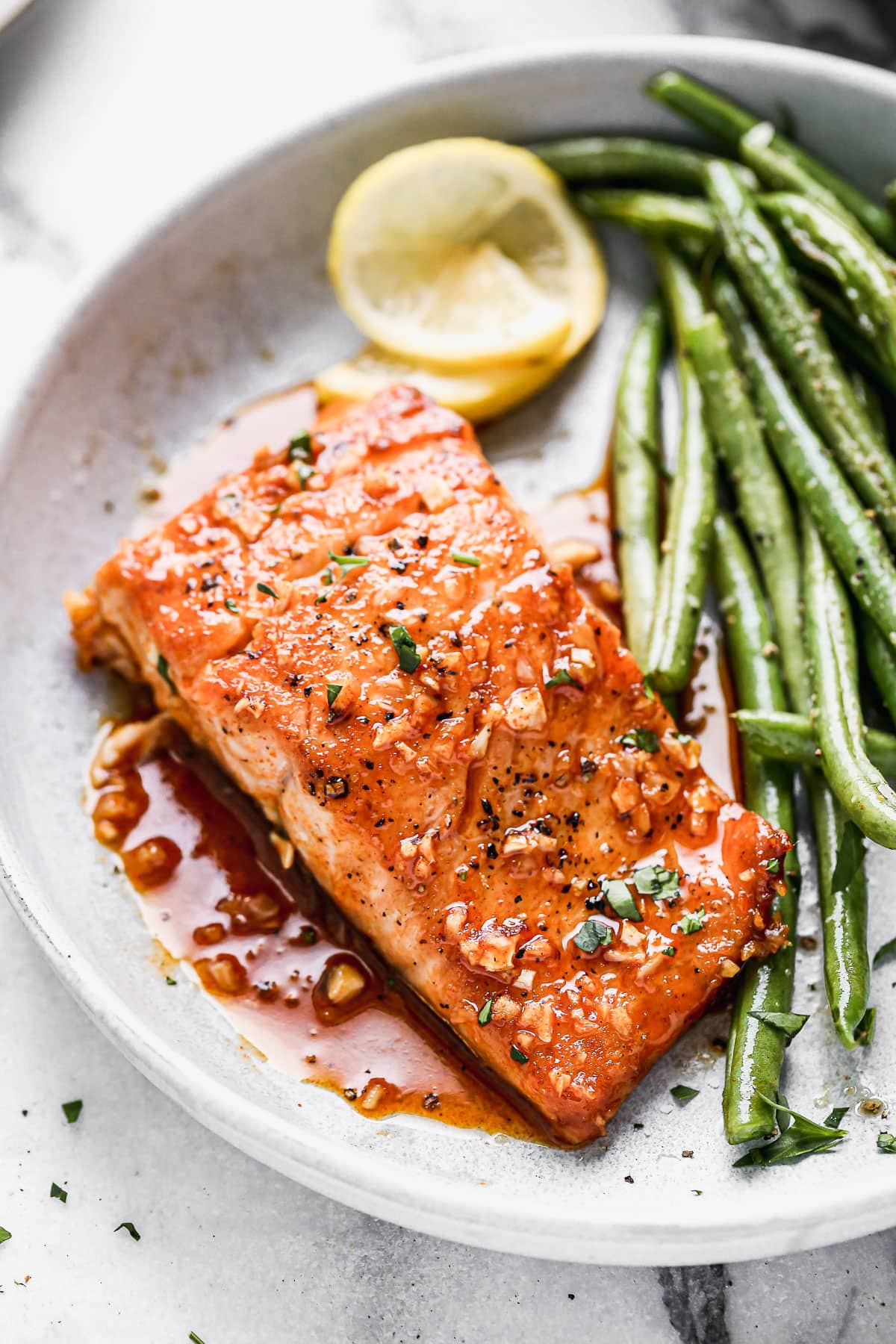 Saucy honey garlic salmon on a plate