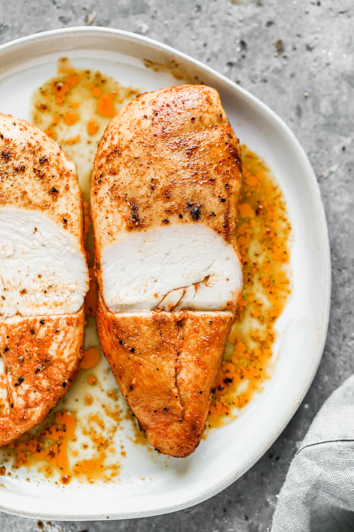 Dry Brined Baked Chicken Breast cut in half