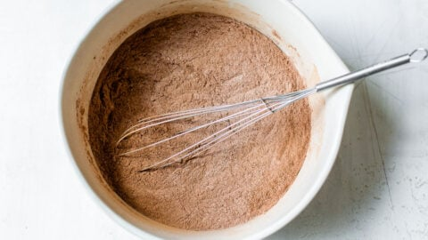 Dry ingredients being whisked in a bowl