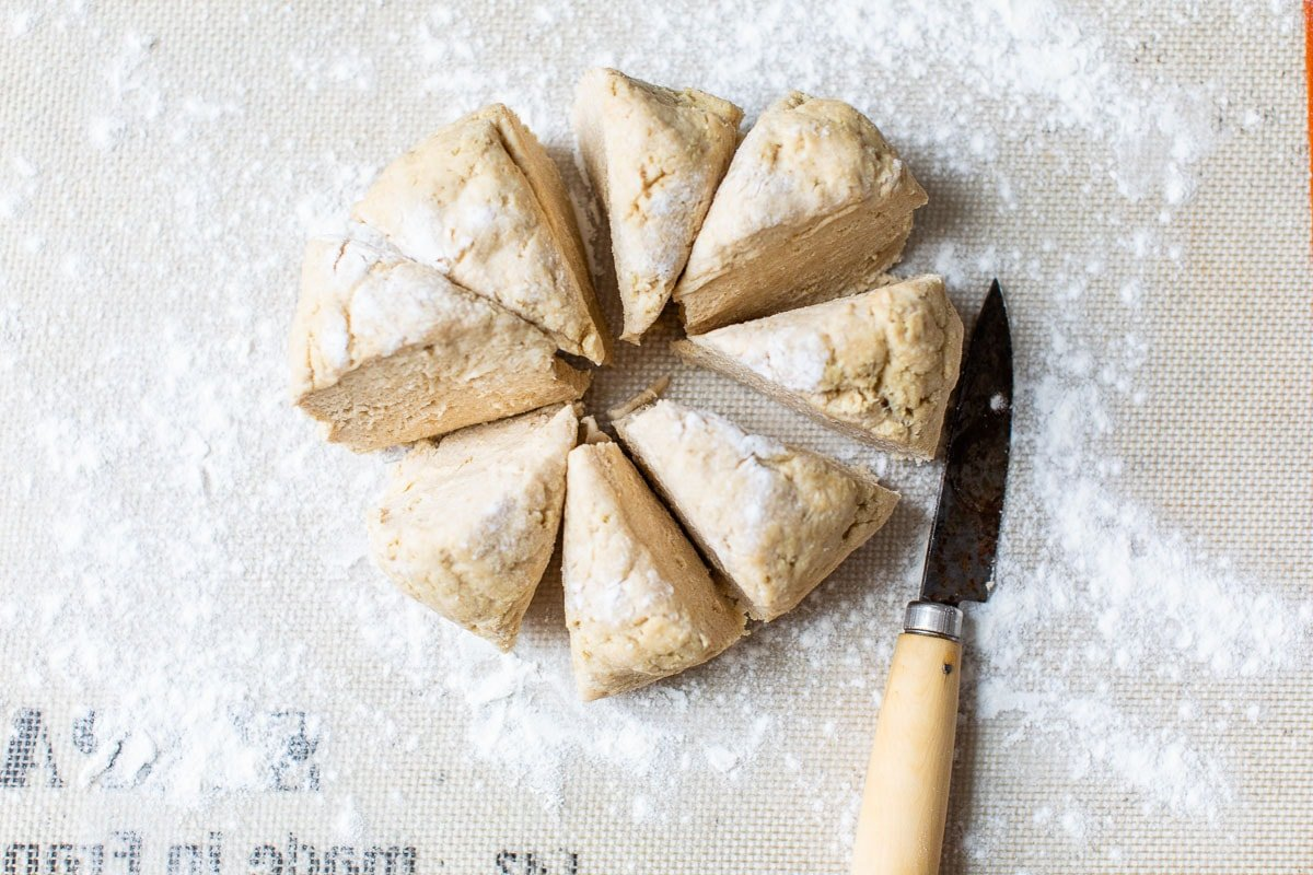 Dough being sliced into pieces