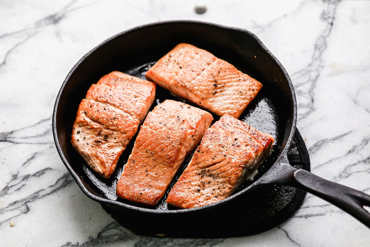 Four fish fillets in a skillet