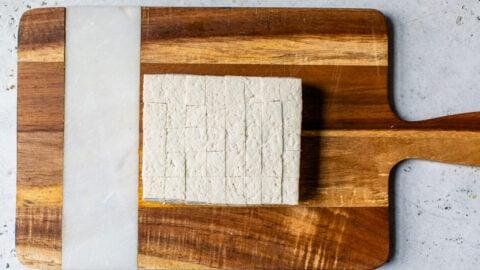 A block of tofu on a cutting board