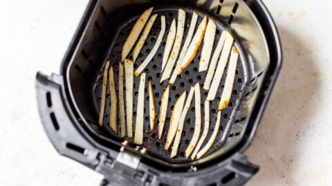 Potato slices in a kitchen appliance basket