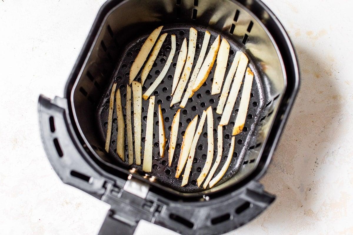 Potato slices in a kitchen appliance basket