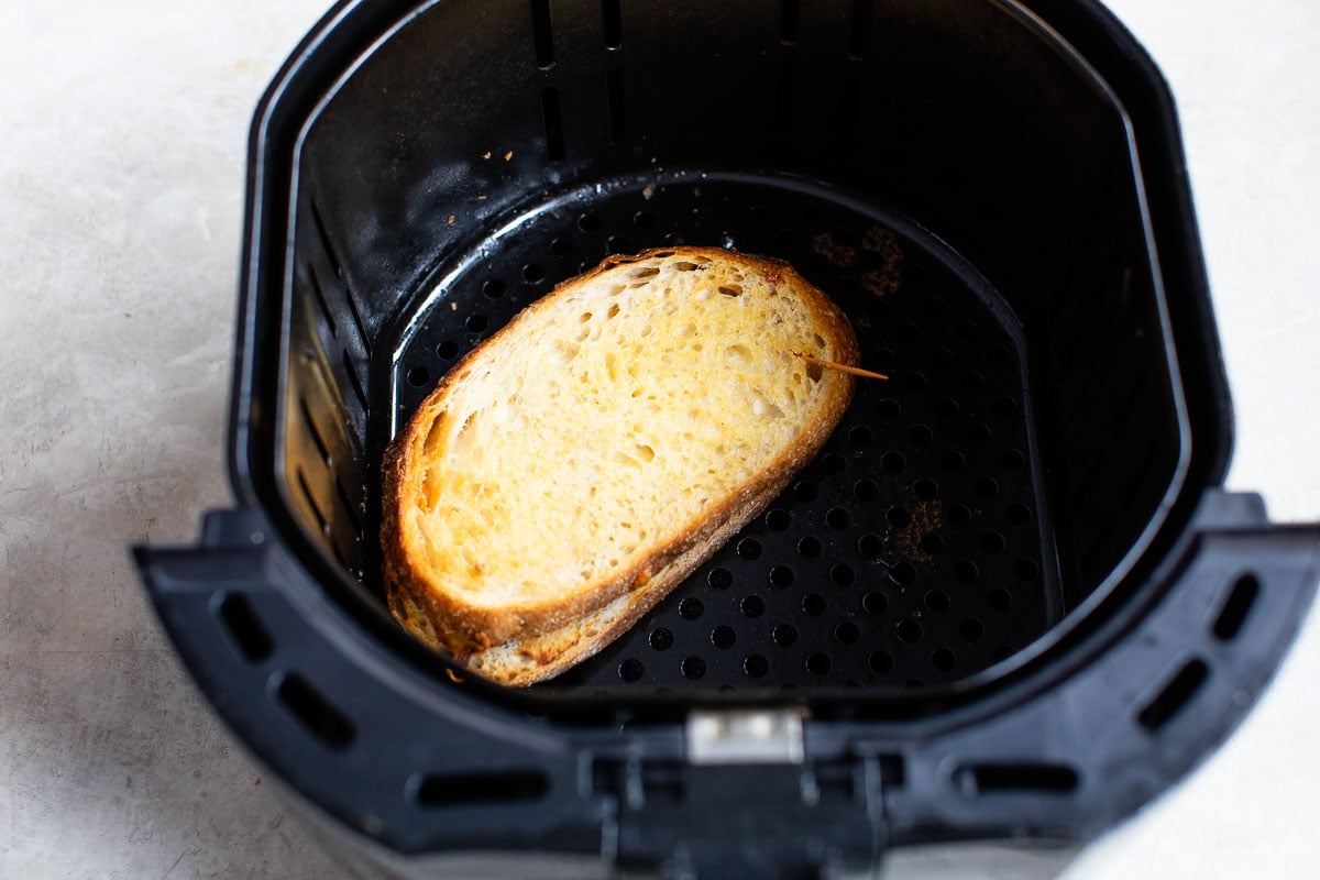 A grilled cheese sandwich in an air fryer