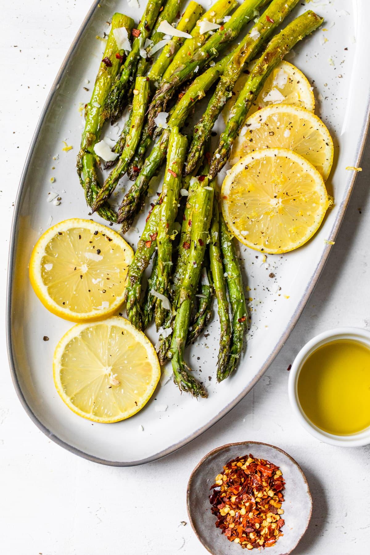 Lemon slices and roasted asparagus