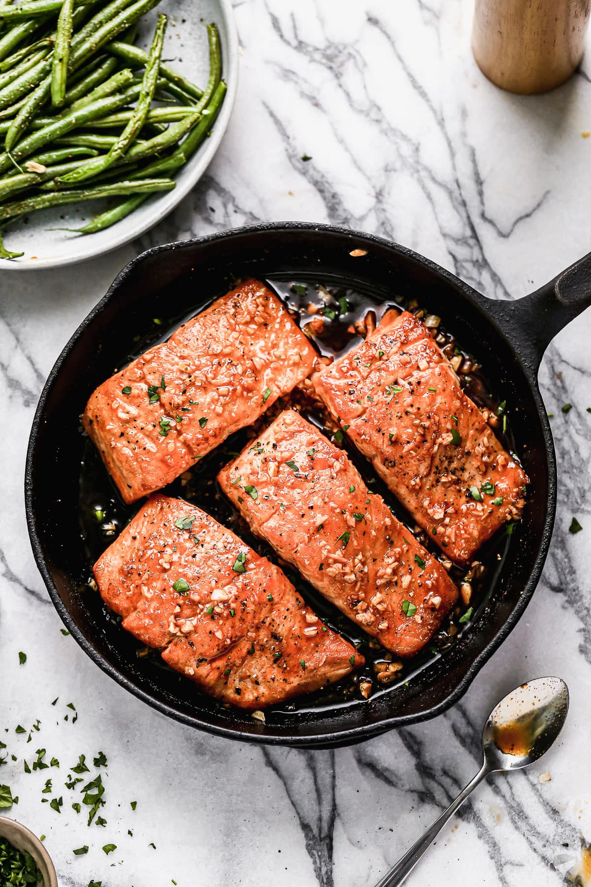 Easy honey garlic salmon fillets in a skillet