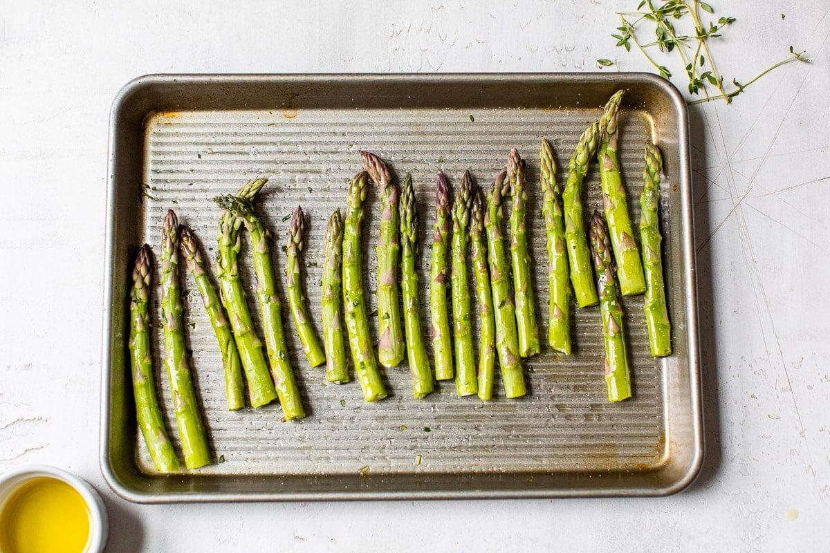 Asparagus spears on a baking sheet
