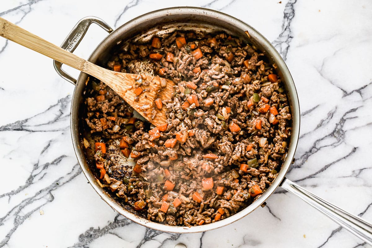 Ground beef and vegetables in a skillet