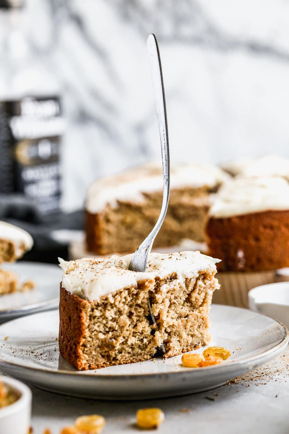 A fork in a slice of applesauce cake