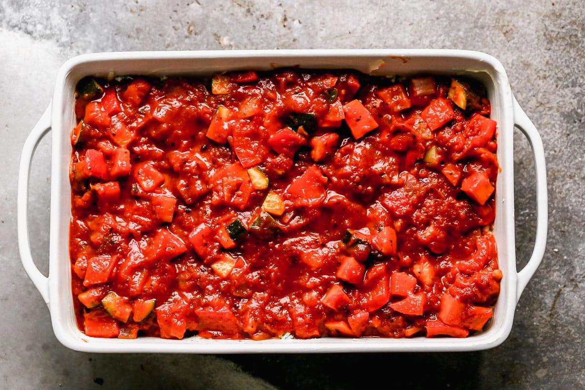 Vegetable lasagna being assembled