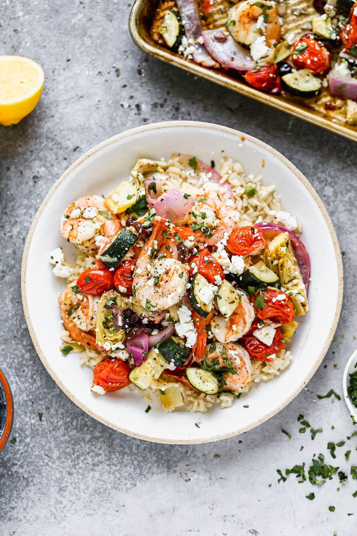 Mediterranean sheet pan shrimp in a bowl