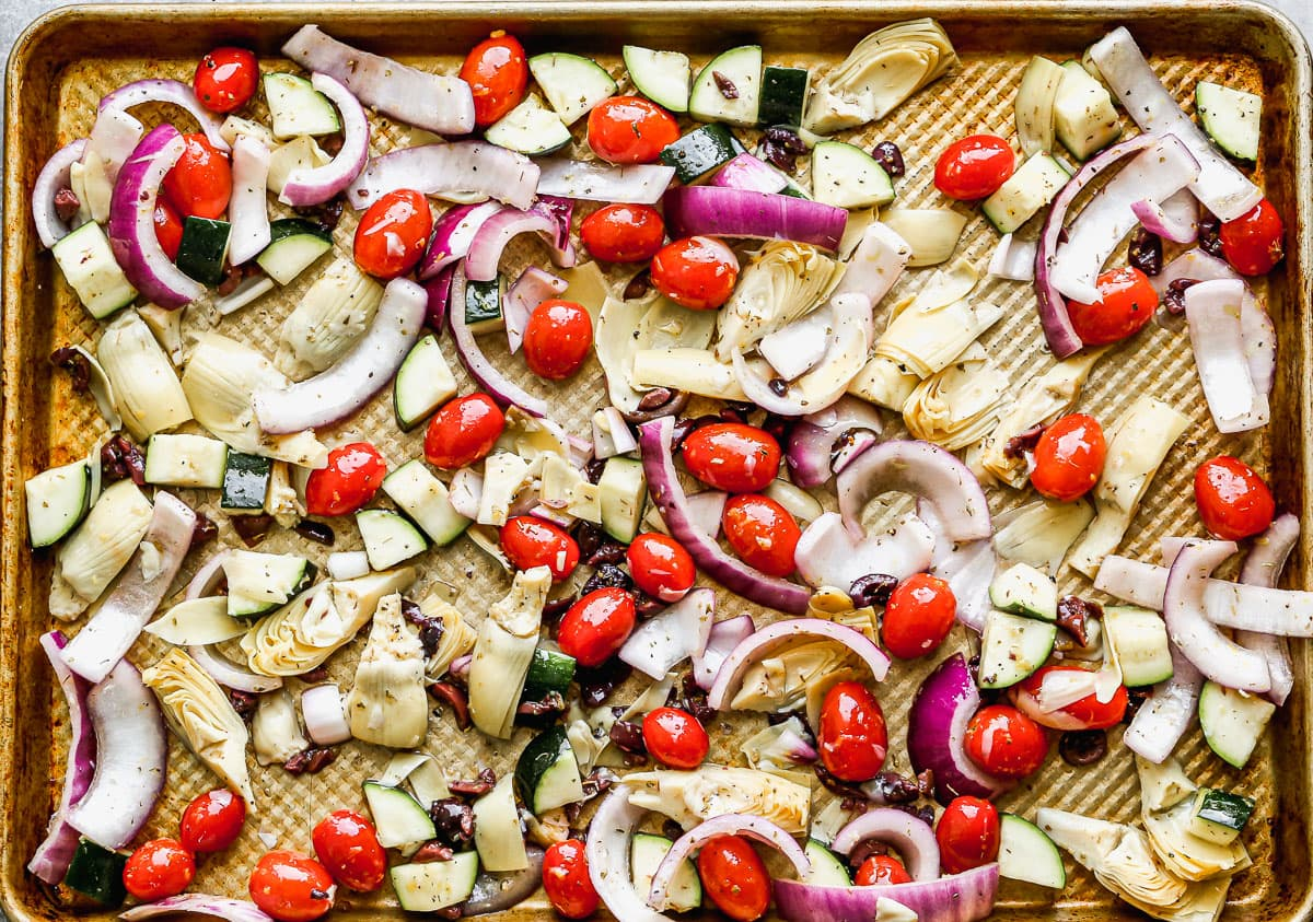 Vegetables being roasted on a baking sheet
