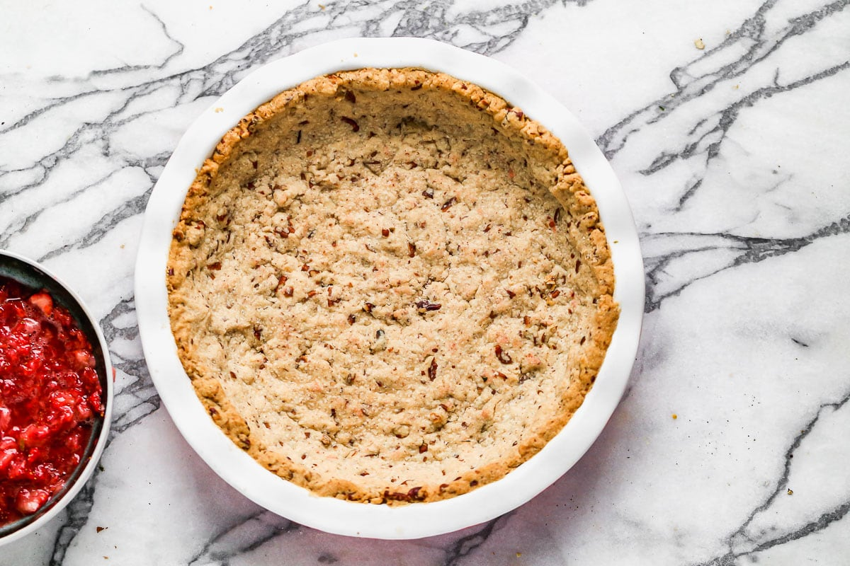 Pecan shortbread crust in a pie dish