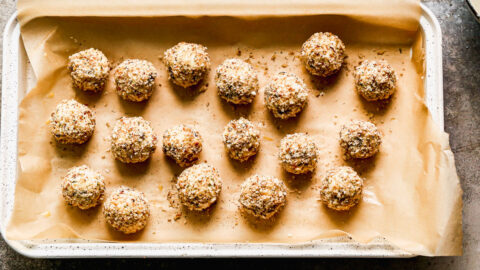 Goat cheese balls on parchment paper