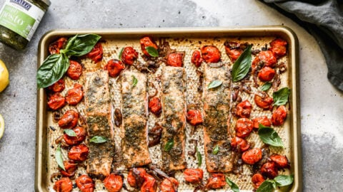Pesto salmon filets on a baking sheet