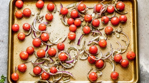 Tomatoes and onions on a baking sheet