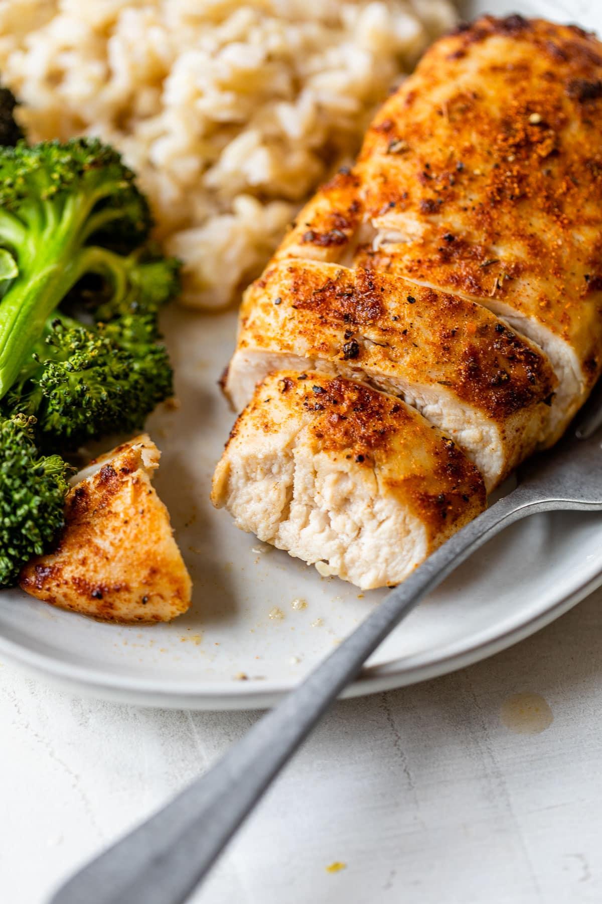 A sliced air fryer chicken breast