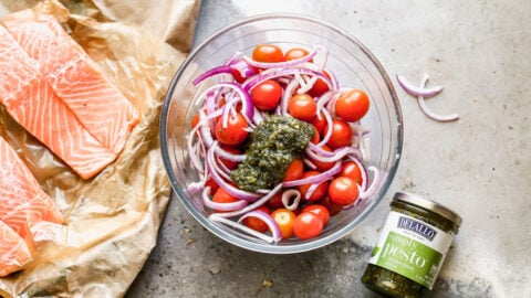 Tomatoes, onions, and pesto in a bowl