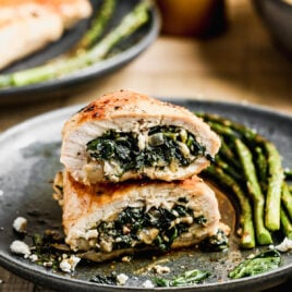 A spinach stuffed chicken breast cut in half
