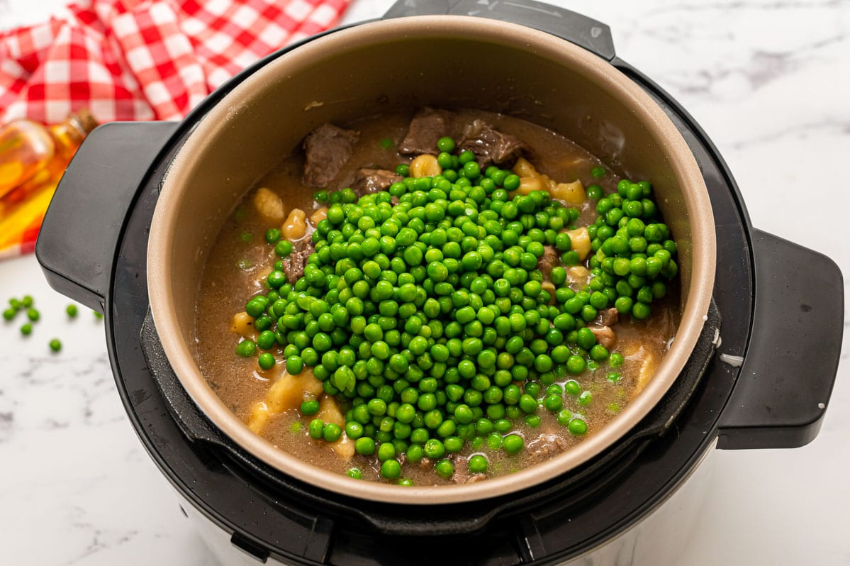 Peas being added to a pressure cooker