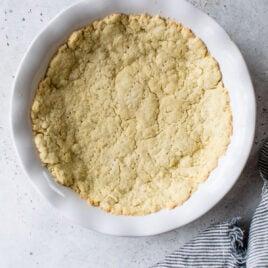 Olive oil pie crust in a pie dish