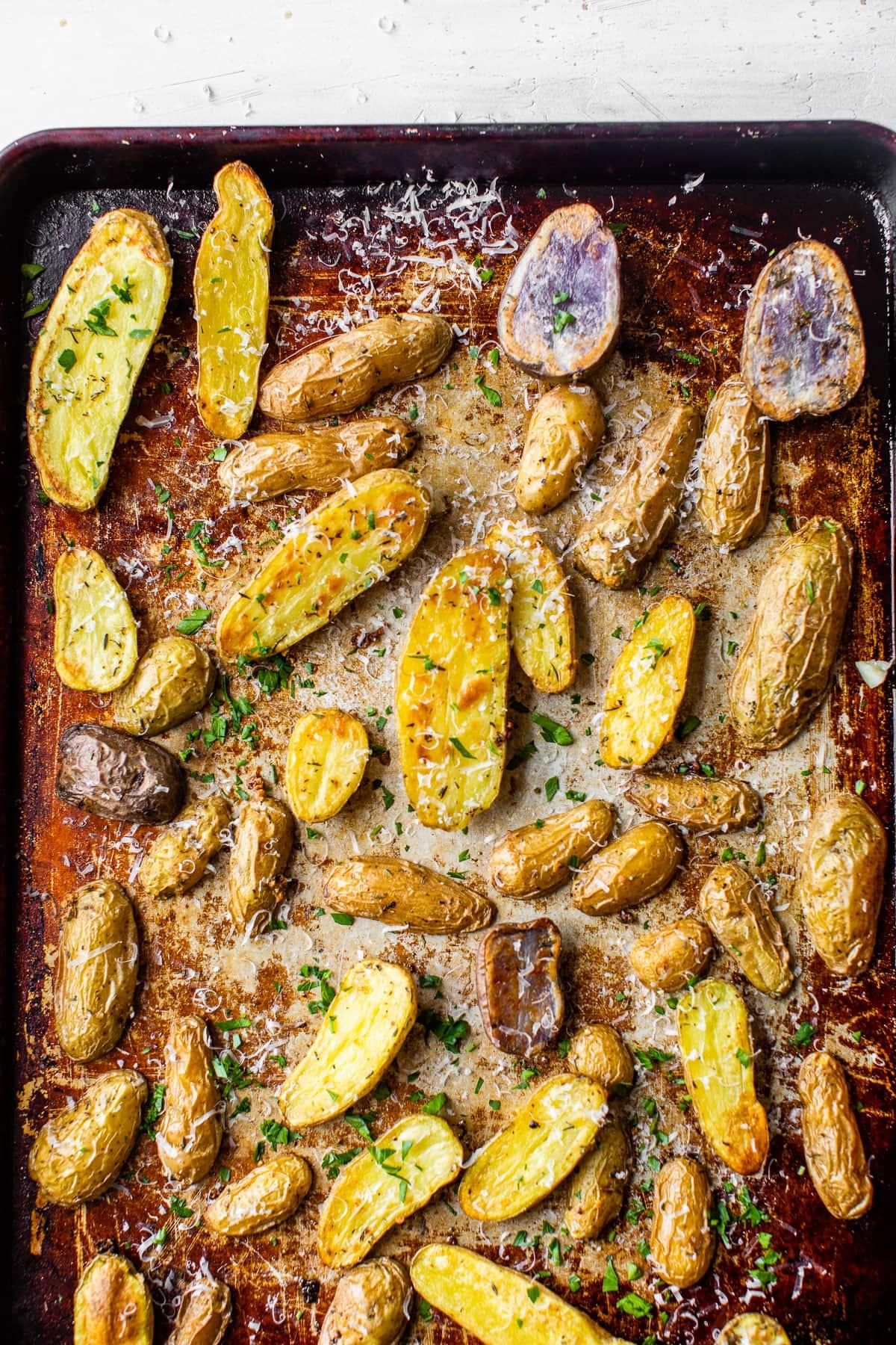 Roasted fingerling potatoes on a baking sheet