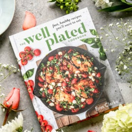 Well Plated Cookbook with spring flowers