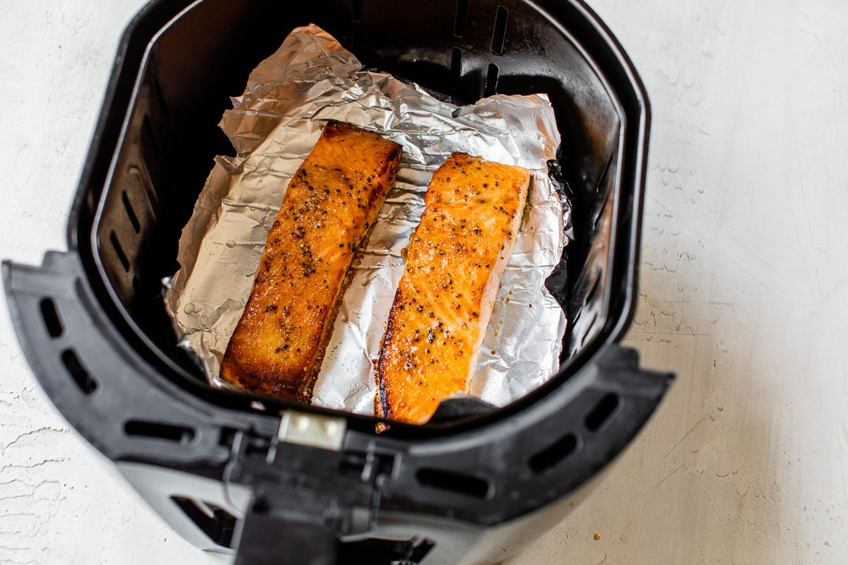 Two pieces of fish on foil